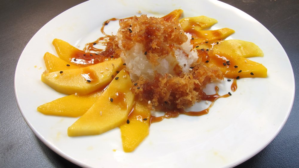 Sticky rice with mango and caramel sauce.