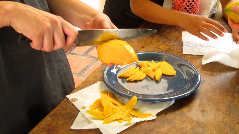 Learning how to cut a mango.