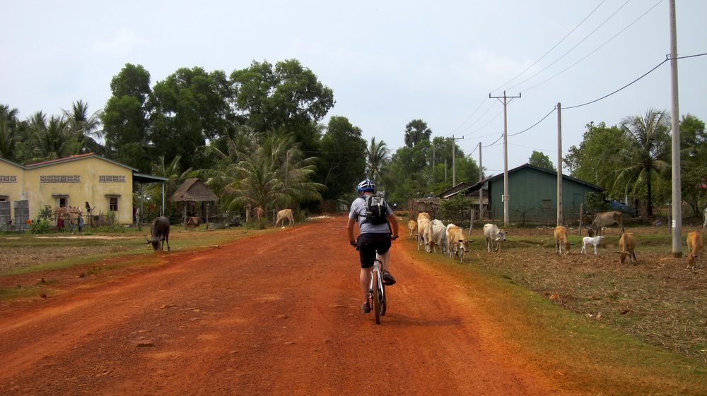 Biking along salt fields, an island and the red dirt roads.