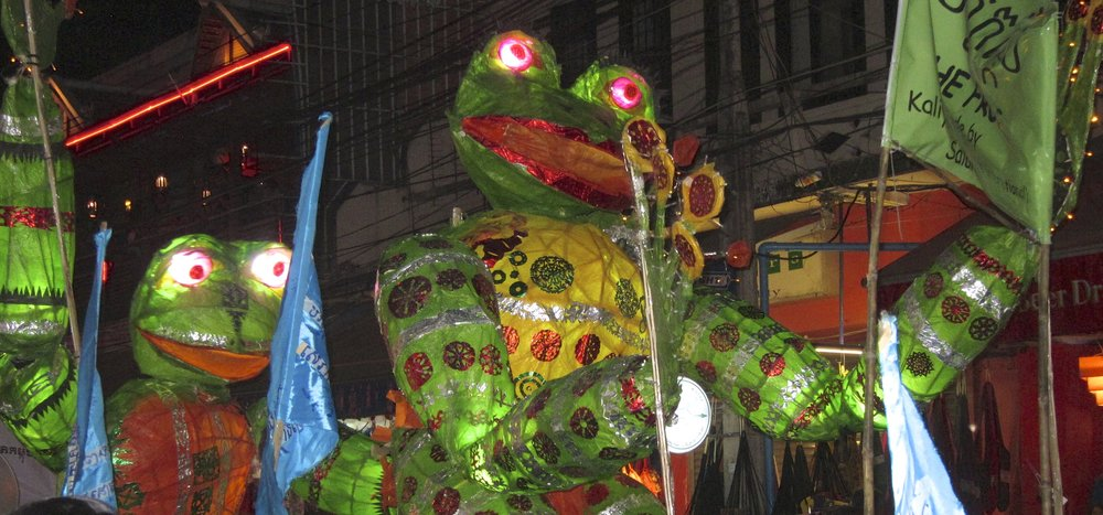 Frogs on stilts! Part of the Giant Puppet Parade.