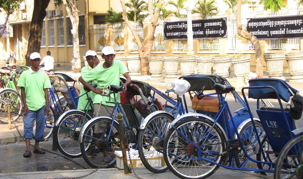 Cyclo drivers waiting to take us around town.