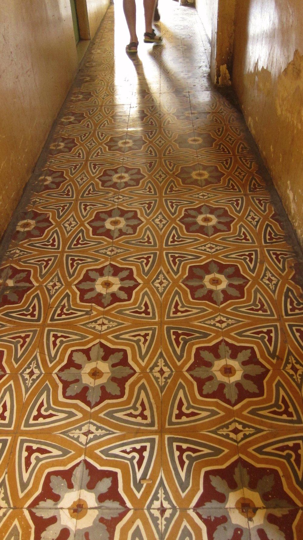 Original tile floor lining the hallways of the Hotel Manolis.