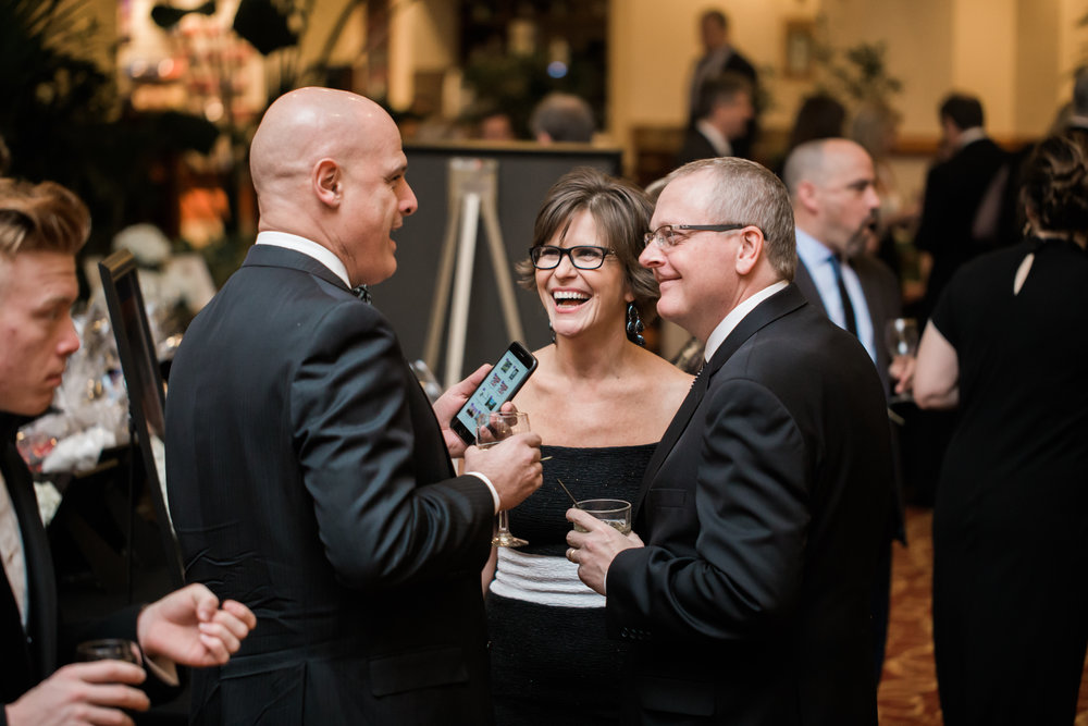 Fellowship Executive Director Pam Orr chats with her husband Barrie, right, and Greg Haecker, at last year's gala.