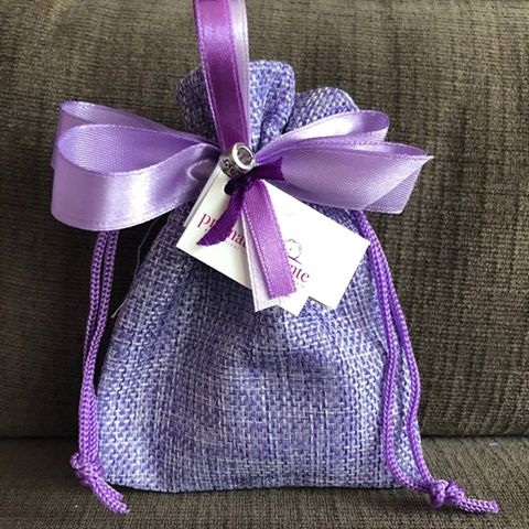 Prematuramente Sack - Our representative sack is made with purple jute, it is connected to the color of prematurity, it is decorated with good luck charms and ribbons.