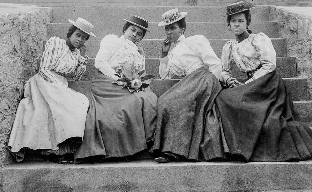 Four African-American women seated on steps of Atlanta University, late 1890's. Image taken from A Small Nation of People: W.E.B Du Bois & African-American Portraits of Progress. Published by The Library of Congress with essays by David Levering Lewis and Deborah Willis (2003). ©The Library of Congress