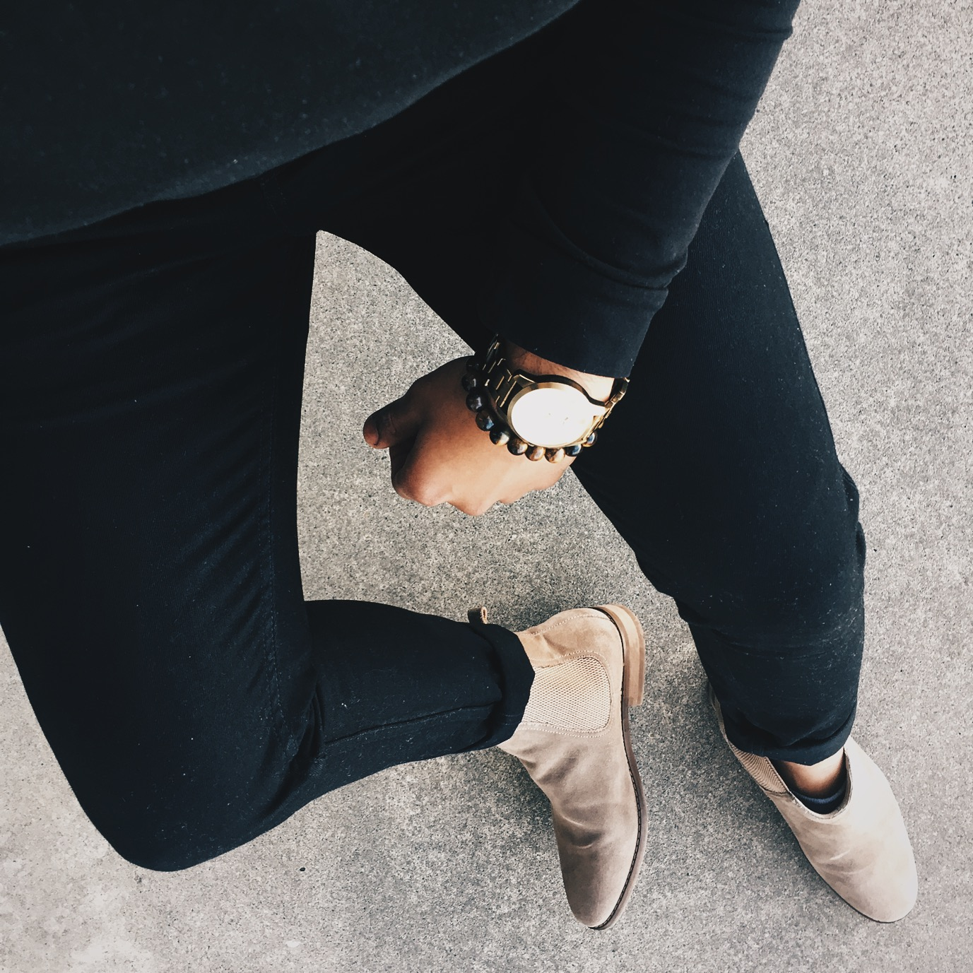 Chelsea boots with black denim, and a black turtleneck