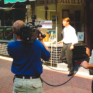 photo John Edwards walks out of store-2.jpg