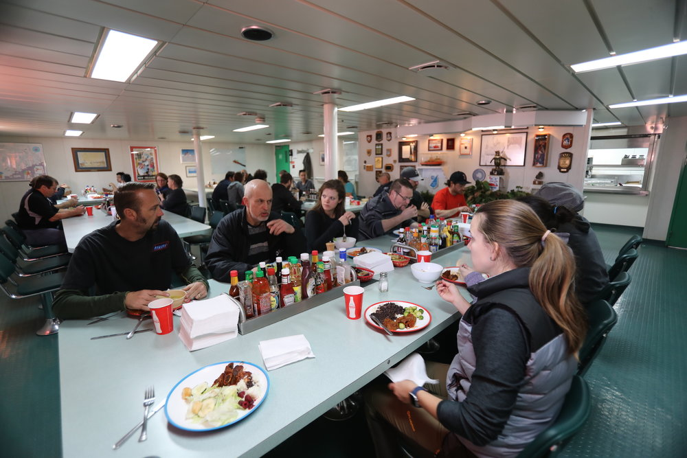 The mess hall is located near the bow the ship. Its outer walls are right next to the ice breaking going on, making conversations difficult to hear at times.
