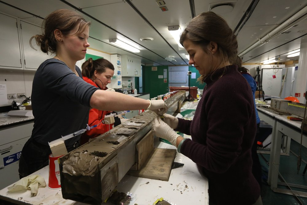 NSF artist in residence writer ELizabeth Rush works with Ph.D. student Rachel Clark to sample the Kasten core.