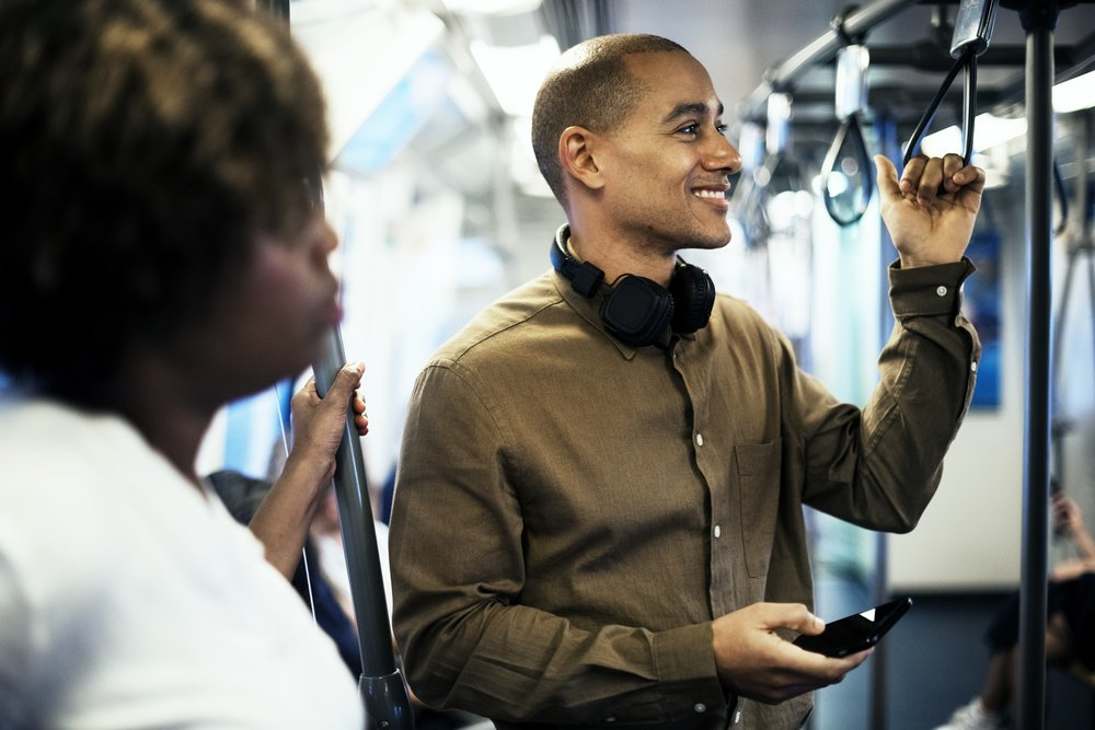 man using phone on bus.jpeg