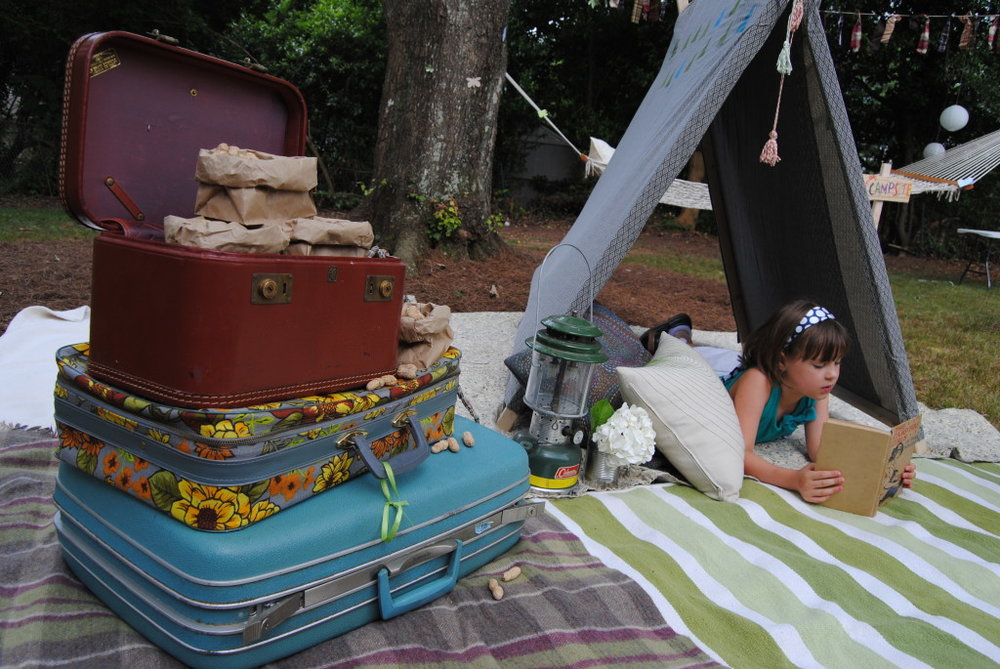 Suitcases with peanuts and a DIY tent