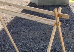Top of A-frame, shorter boards nailed to the outside of frame.