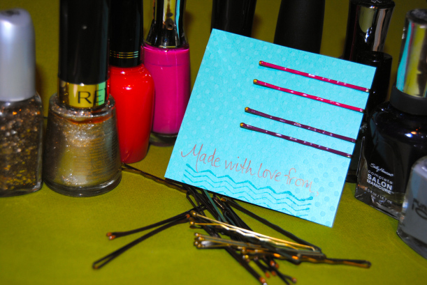 Adding color to bobby pins could not be easier with nail polish. Present on nice card stock. Use as a gift or punch a hole in the corner and use as a gift tag!