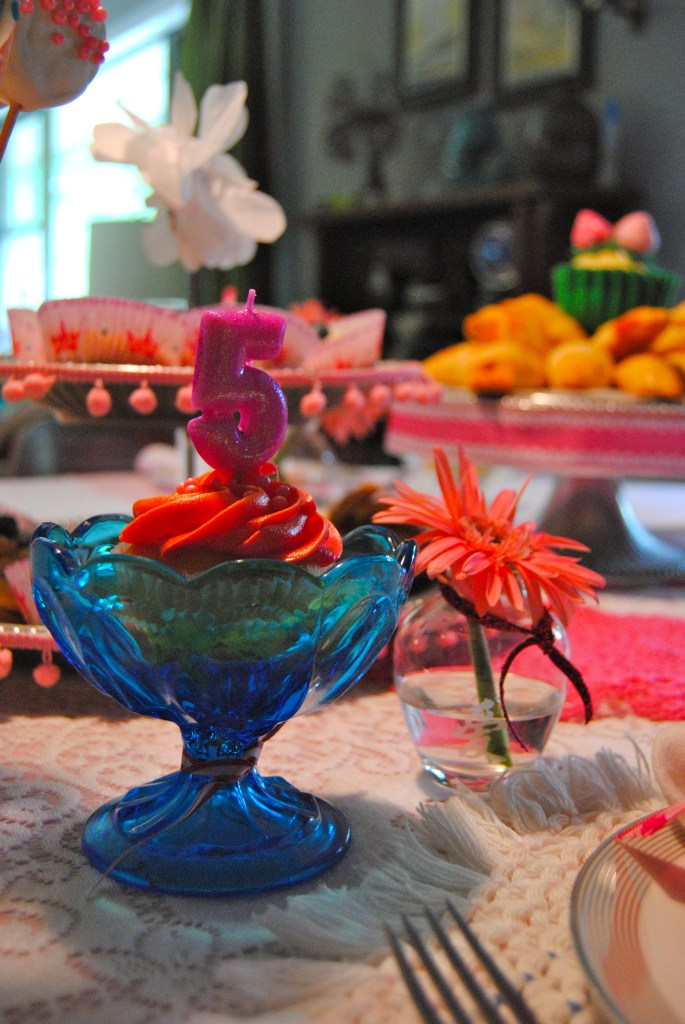 Anna's cupcakes sits atop a vintage dish and gets a glitter 5.
