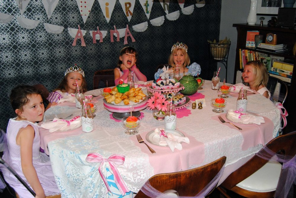 The pretty princesses enjoy their tea party!