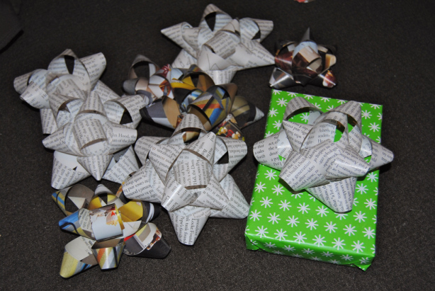 And you did it! Bows that are MUCH cuter than purchased ones. Now open that present carefully!