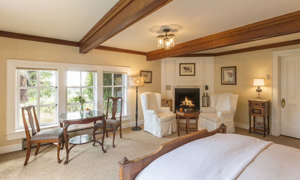 The East Farmington room with sitting area by the crackling fire