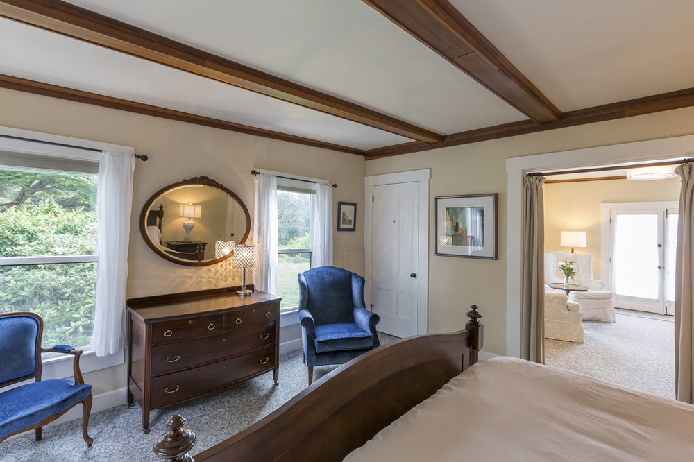The Eastlin Suite with antique furnishings, large view windows, and second sitting room.