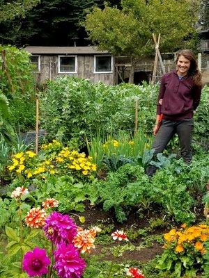 Maggie in the overflowing garden