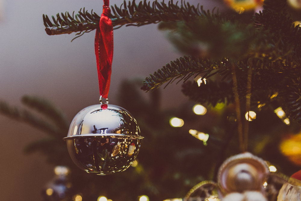 A shiny ornament in an evergreen tree