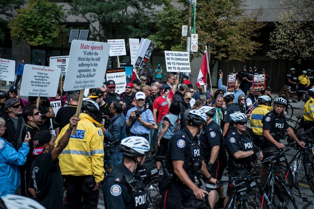 Far-right demonstrators wait as their march is stalled by an Antifa counter-demonstration. The police stand between the two sides. (ALI JAVEED/THE UNDERGROUND)