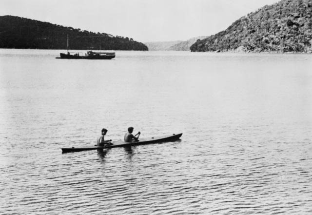 Leading Seaman Frederick W L Boof Marsh and Ordinary Seaman L K Tiny Hage of Z Special unit Australian Services Reconnaissance Department paddling a home made experimental two man canoe HMAS LYON a.jpg