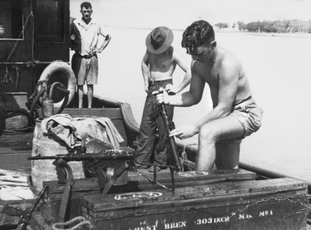 SRD on board  Krait cleaning checking weapons before their attack on Singapore in 1943 in the photograph are Mark 1 42 Owen machine guns They  appear to  have been painted black.jpg