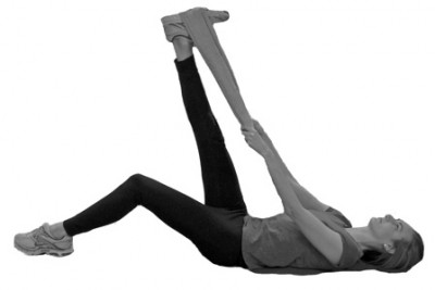 This stretch shows poor technique with the lower back rounding out to the floor and the hips coming off the ground. This gives the illusion of a 'better' stretch as the leg is higher but actually avoids hitting the tightest spots.