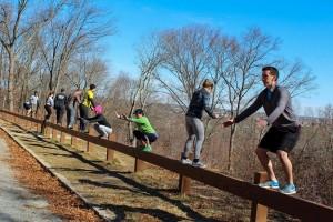 """Exercisers practising the Movnat """"balancing shuffle"""" and """"balancing squat"""""""