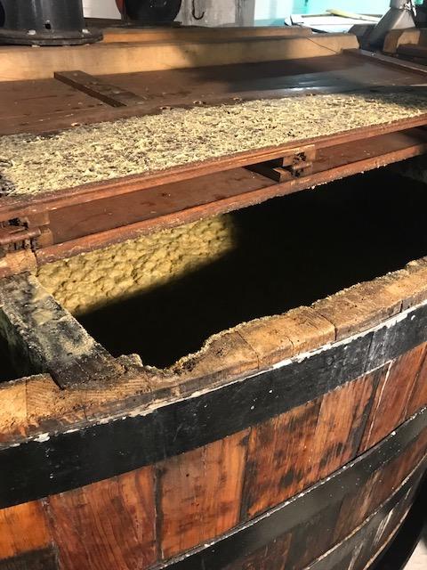 Mash under fermentation in traditional wooden washbacks
