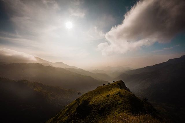 These days I just can't stop thinking about #travel and how much it inspires me in many, many ways. This is a shot from 2014 when me and @nutty1262 hiked to #littleadamspeak in the early hours of the morning to watch the sun rising over Ella's beautiful hills. One of my favourite spots in the world!  #travelphotography #ellasrilanka #srilanka #landscapes #nomadcollective #mountains #hills