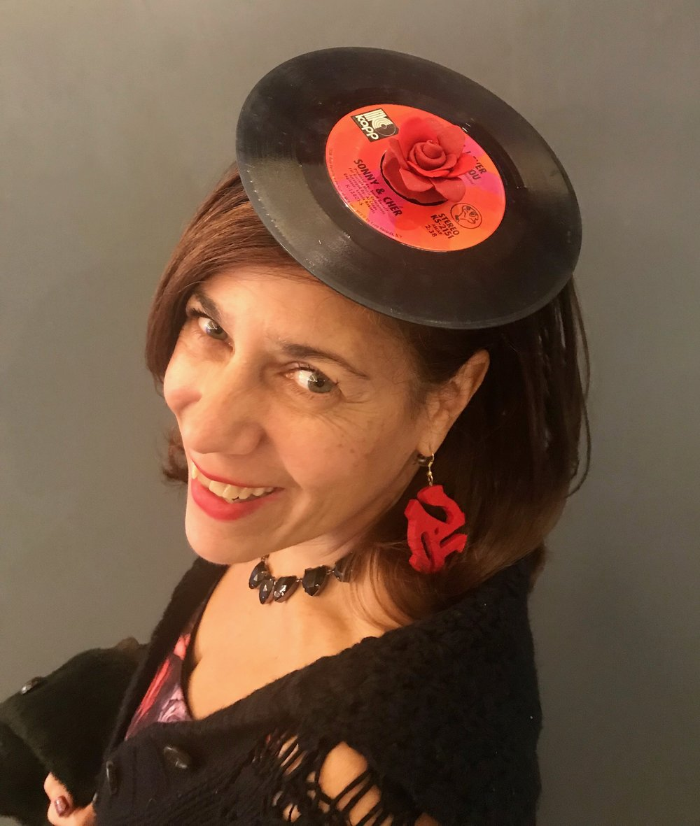 Day 325. Made a Fascinator with a Sonny and Cher 45 and a Rose made out of Sculpey