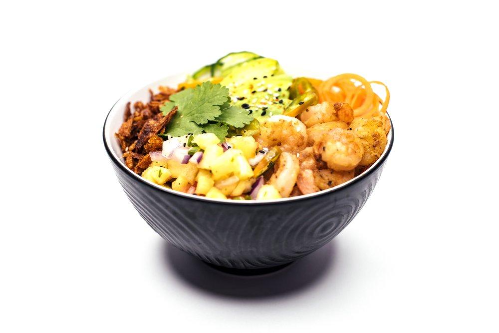 CRUNCHY PRAWN BOWL - Pan Fried Prawns, Rice, Cucumber, Carrot, Coriander, Jalapeños, Crispy Potato Flakes, Creamy Wasabi Sauce