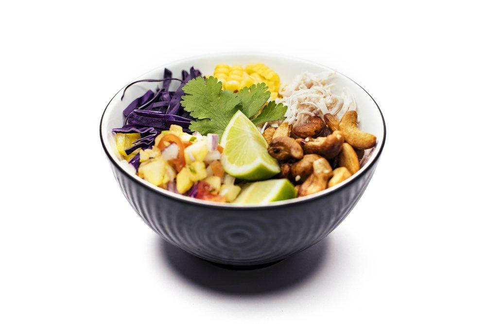 CASHEW CHICKEN BOWL - Shredded Chicken, Rice, Sweet Corn, Pineapple Salsa, Quarter Lime, Honey Sesame Cashews, Coriander, Creamy Togorashi Sauce