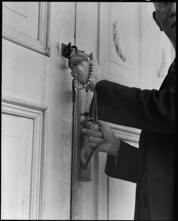 Rev. Shozen Naito locking up the doors to the Buddhist temple in Florin, California as he is forcibly removed by the U.S. Army to an incarceration camp - National Archives and Records Administration, 1942