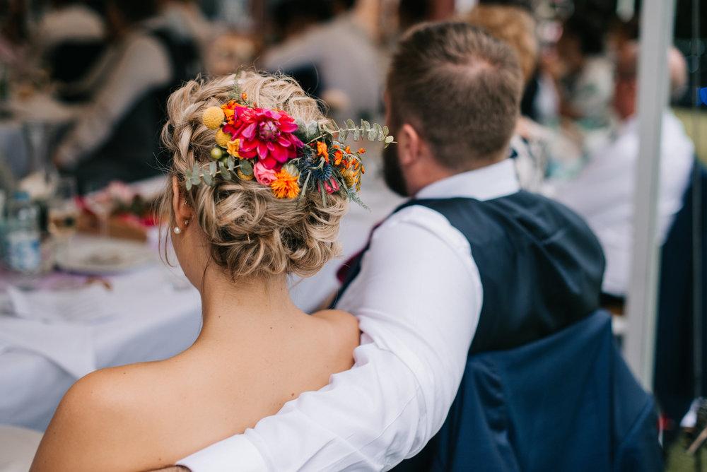braided updo with fresh flowers bride.jpg