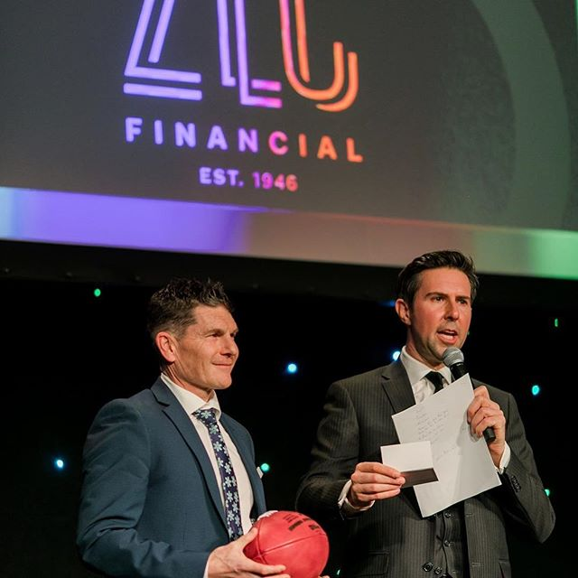 Such an epic moment having John Lutrin from @zlc.financial present the football to the winner of our Ultimate Quarterback Challenge - signed by the legendary @thejerryrice80 & @joemontana ! Thank you ZLC for helping bring these amazing Keynotes to #JCCSportsdinner !