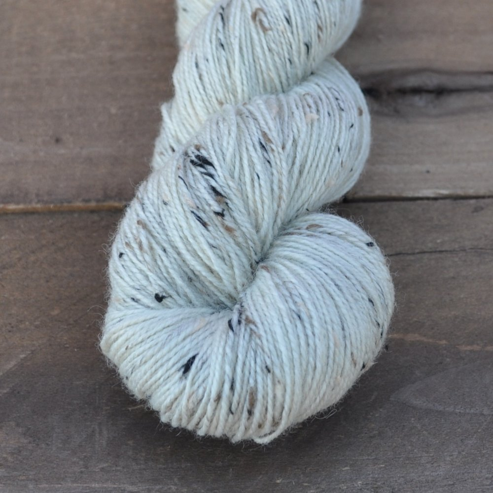 RUSTIC SOCK - if you haven't tried bluefaced leicester wool (bfl), you're missing a real treat! add in black & cream flecks and you've got the most gorgeous tweed sock yarn. bfl is sturdy as can be, but still has a fabulous hand. we call it
