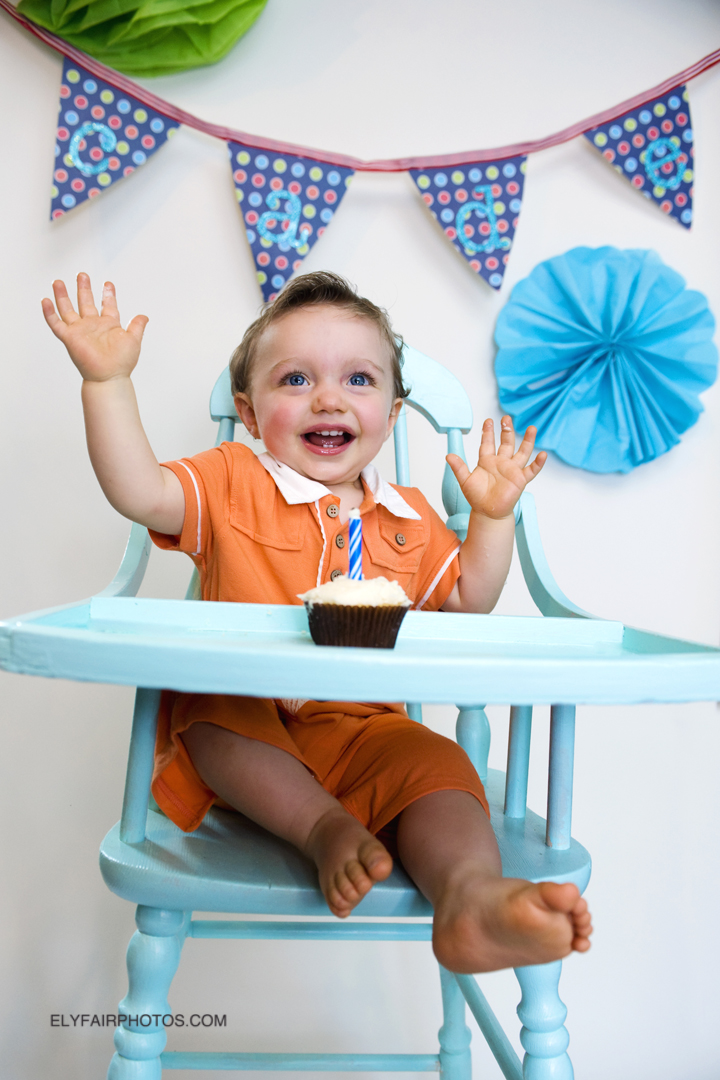 Cade enjoying his first birthday in the blue high chair.
