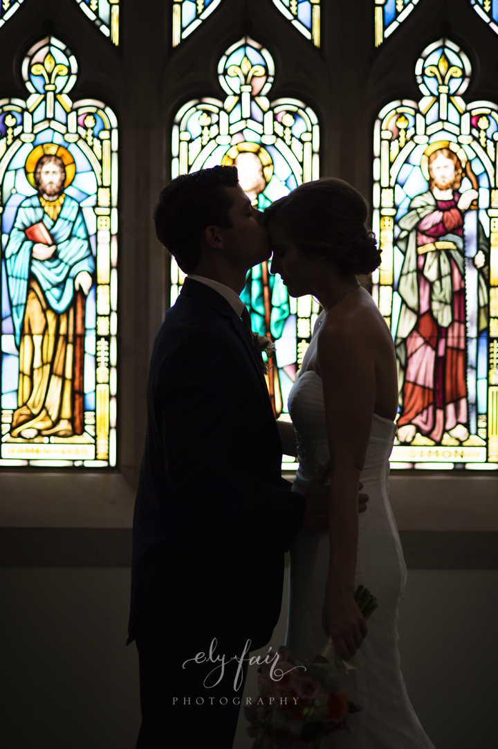 Bride & Groom in front of stain glass