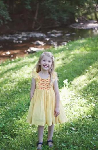 Savannah wearing a Sunshine Netti smocked dress