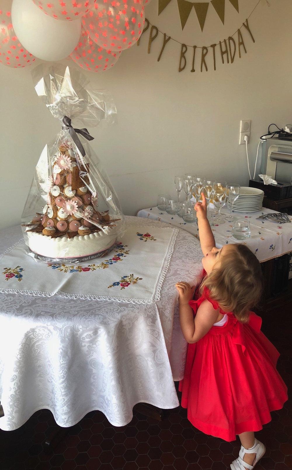 Darling Chiara celebrating her birthday in our red Poppy Netti dress