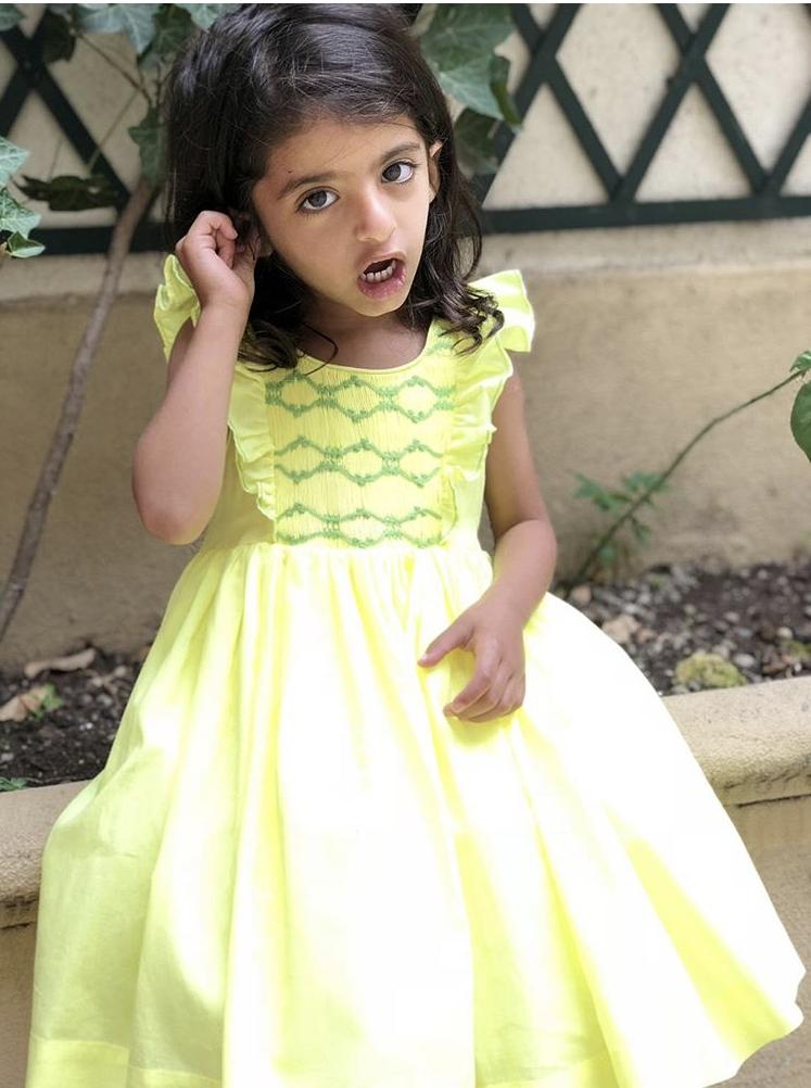 Beautiful little princess in her handmade yellow Netti dress