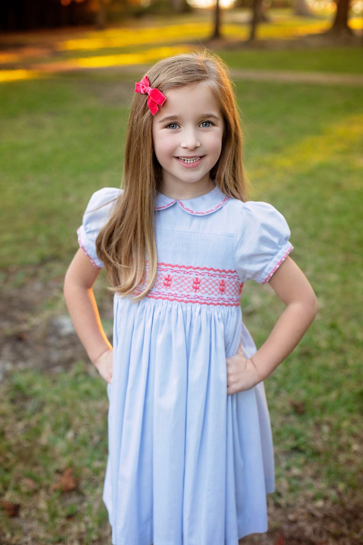 Christmas card Frazier in her handmade Princess Charlotte smocked dress