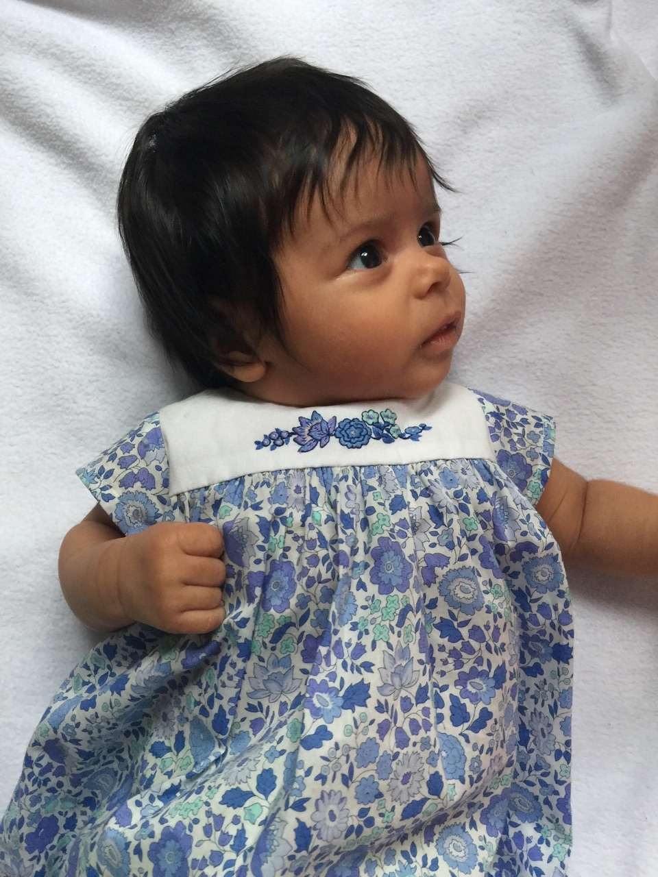 Nina in her handmade Liberty dress with delicate embroideries