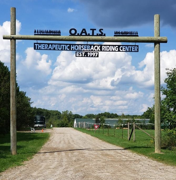 Entrance to the O.A.T.S. driveway with sign