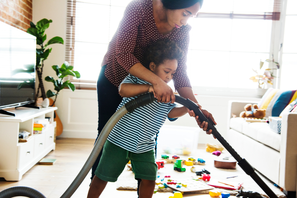 mom vacuuming with daughter