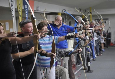 Members of the Laguna Woods Archery Club participate in the club's first competition at a specially set-up shooting range in the shuffleboard room at Clubhouse PHOTO BY JEFF ANTENORE, CONTRIBUTING PHOTOGRAPHER –