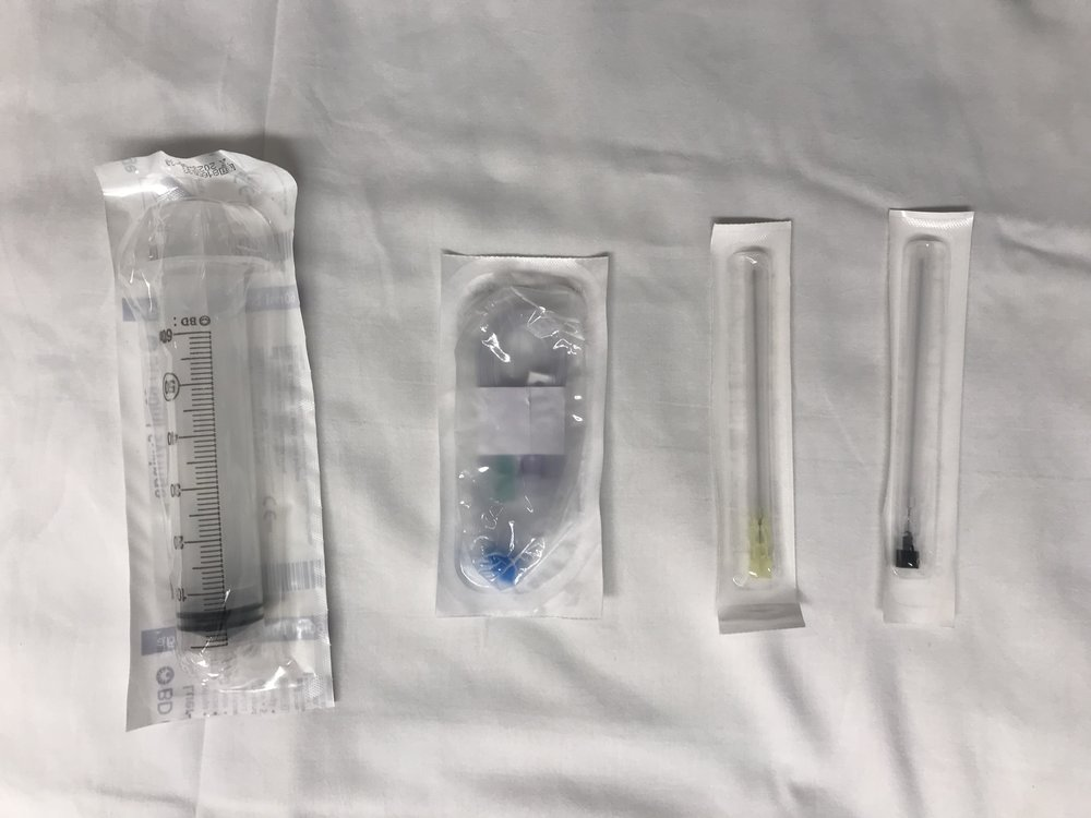 Obtain a 60cc syringe, extension tubing and a spinal or tuohy needle.