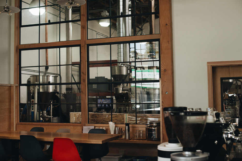 A view into the CoRo roastery from the cafe.